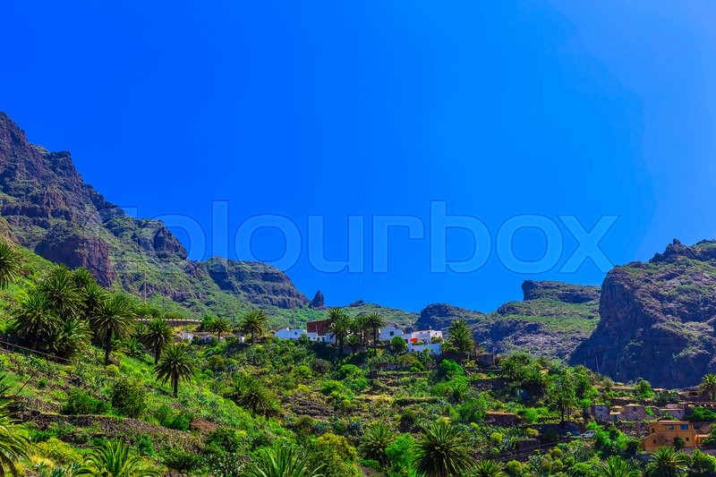 Small Village and Buildings in Green Mountains Landscape on Tenerife Canary Island in Spain, stock photo