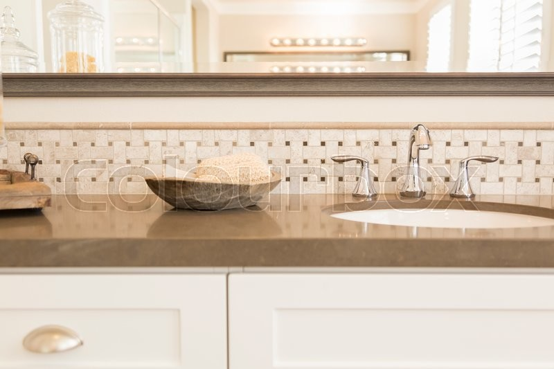 Beautiful New Modern Bathroom Sink, Faucet, Subway Tiles and Counter. , stock photo