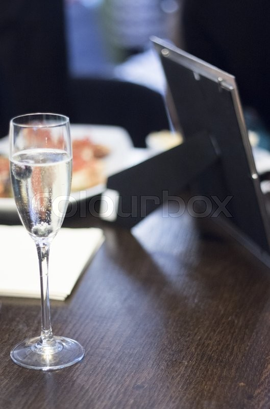 Champagne sparkling white wine glasses in restaurant bar in wedding reception party photo, stock photo