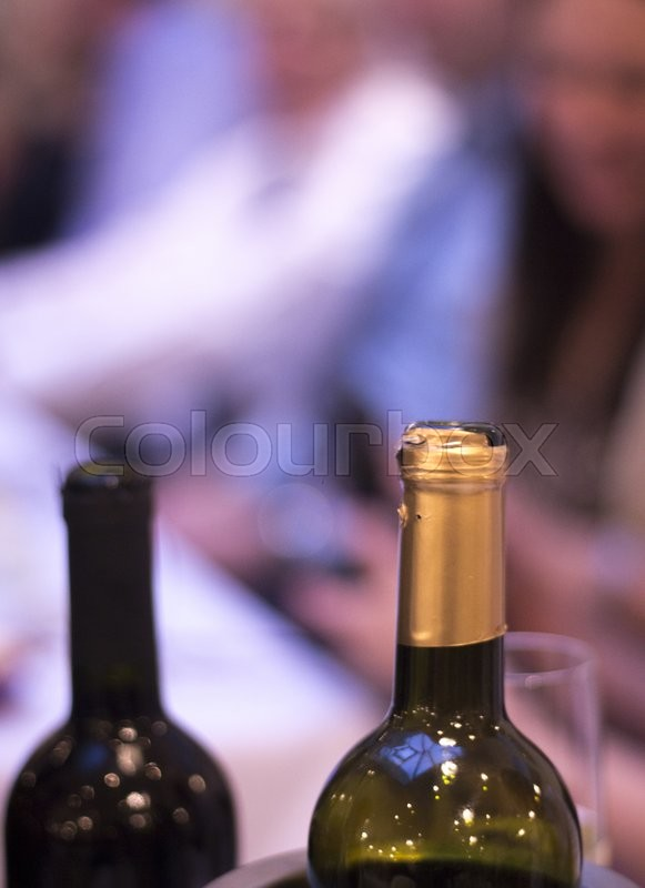 White and red wine bottles in wedding reception party dinner in restaurant photo, stock photo