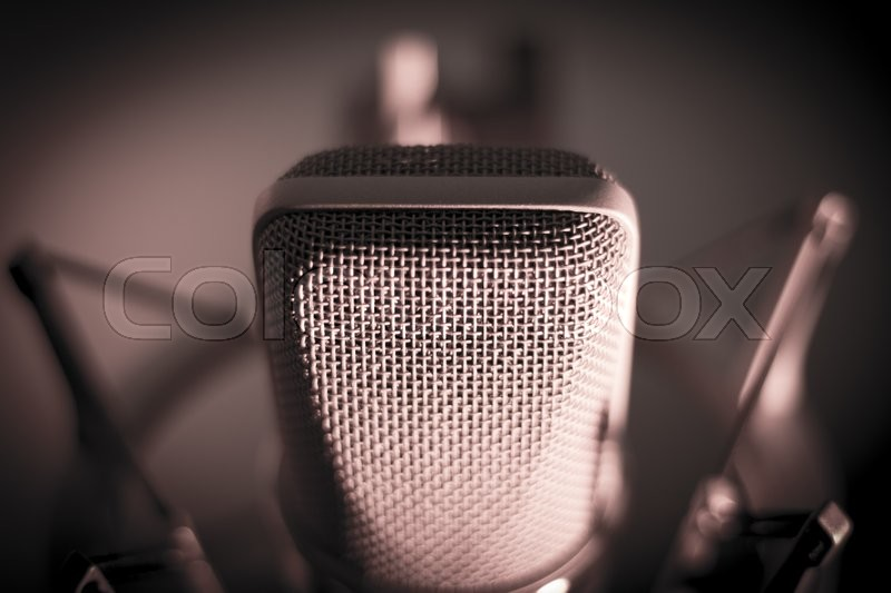 Audio recording vocal studio voice microphone with anti shock mount and built in anti pop filter for singing and voiceover actors doing voiceovers, stock photo