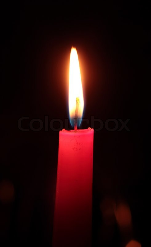 Single red candle on a black background | Stock Photo ...