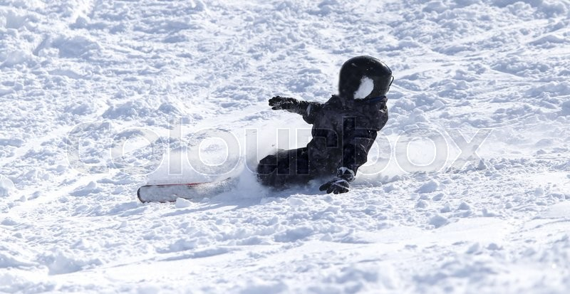People snowboarding on the snow in the winter, stock photo