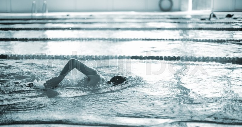 Swimmer swimming breast stroke in pool competition lane photo, stock photo