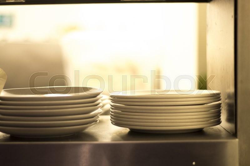 Plates in restaurant cafe kitchen photo, stock photo