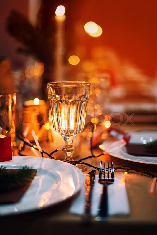Decorated Christmas holiday table ready for dinner. Beautifully decorated table set with candles spruce twigs plates and serviettes for event in the ... & Decorated Christmas holiday table ready for dinner. Beautifully ...