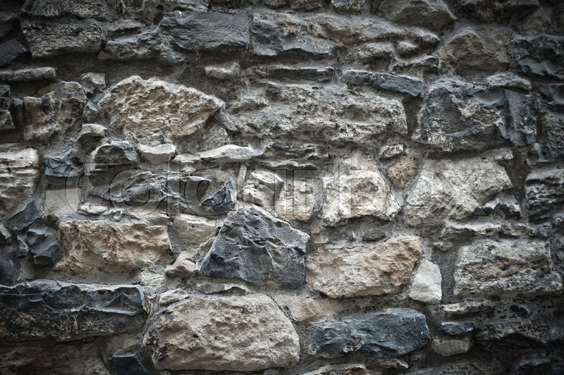 Dramatic texture of old stone european house wall | Stock ...