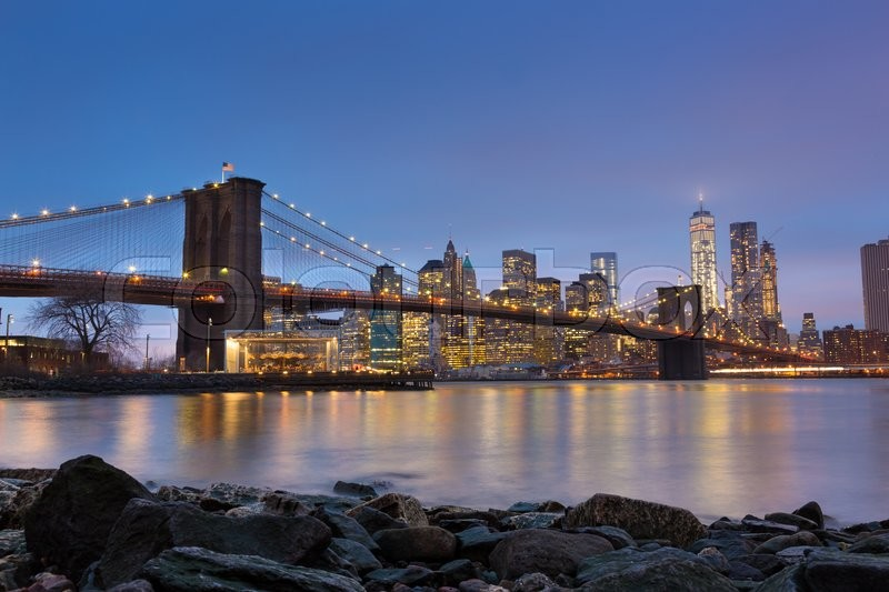 Brooklyn bridge and new york city manhattan downtown skyline at dusk