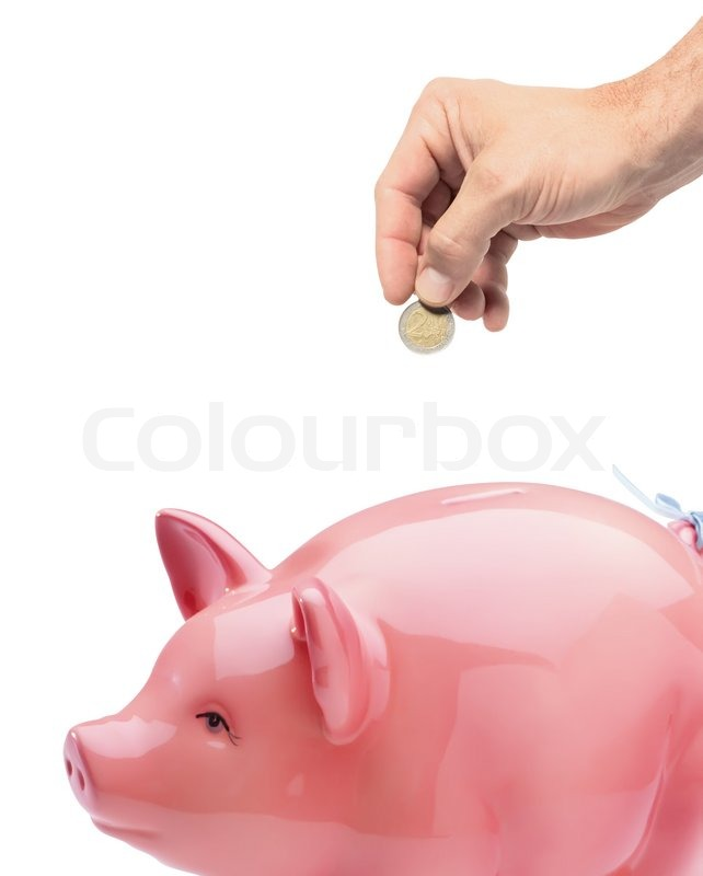 hand putting money into the piggy bank isolated on white