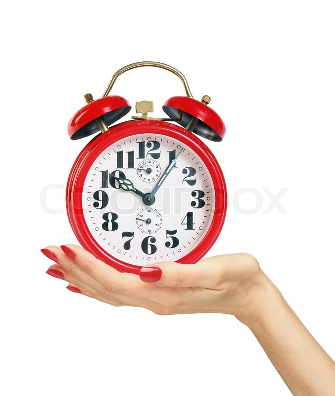 red alarm clock in woman hand isolated on white background stock photo colourbox. Black Bedroom Furniture Sets. Home Design Ideas