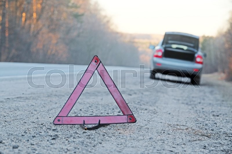 The image of an emergency sign on a road, stock photo