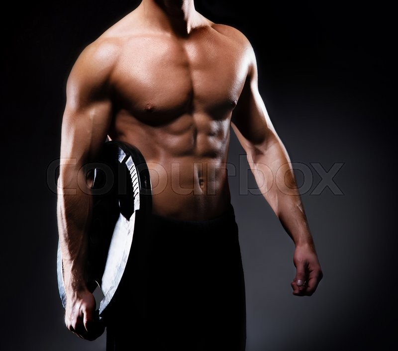 Strong, fit and man with muscular body having a workout with barbel ...