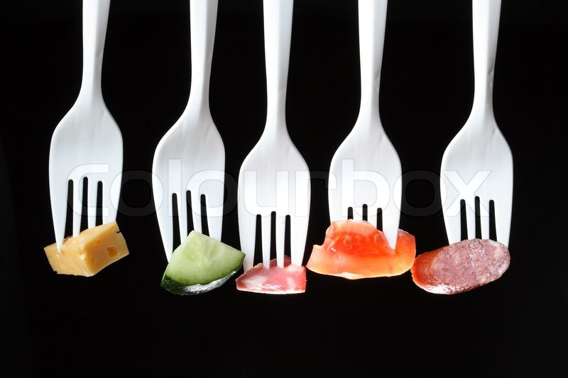 Five White Plastic Forks In A Row With Stock Photo
