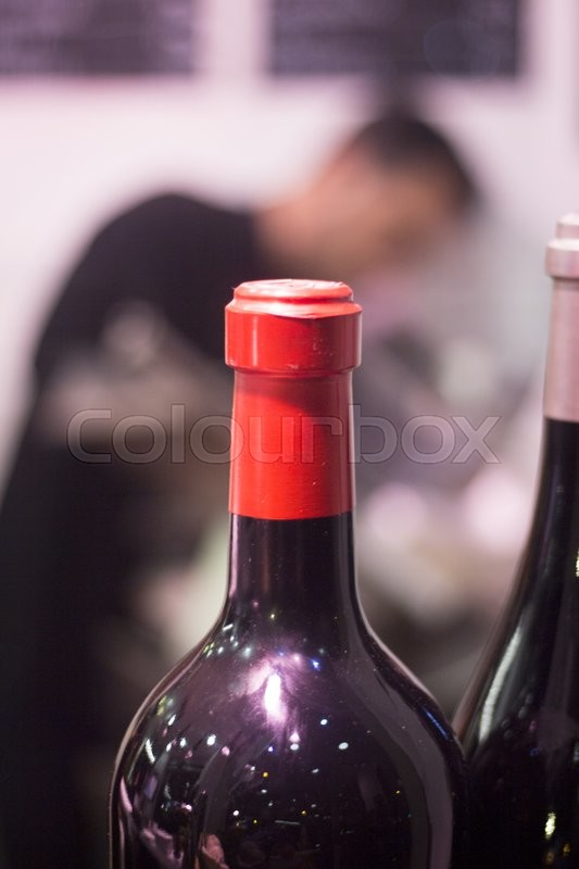White and red wine bottles in party dinner in restaurant photo, stock photo