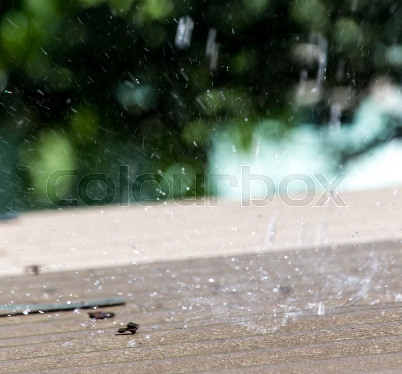 Storm rain on the roof of the house, stock photo