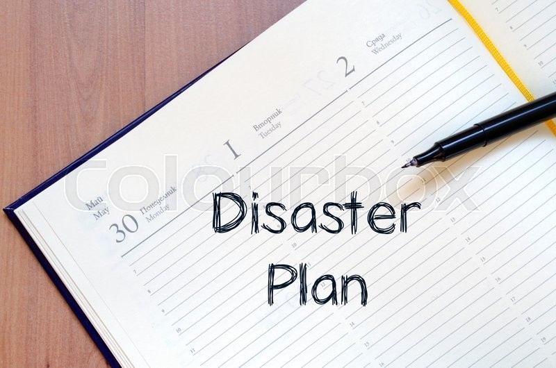 Disaster plan text concept write on notebook with pen, stock photo