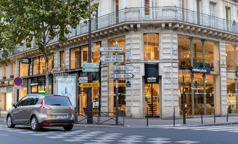 France, Paris 01 November 2015: Urban crossroads in Paris, with cars on the road, stock photo