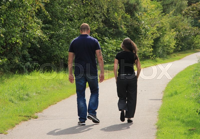 Couple, young man with tattoo and wife discuter their problems in the wonderful park in the summer, stock photo