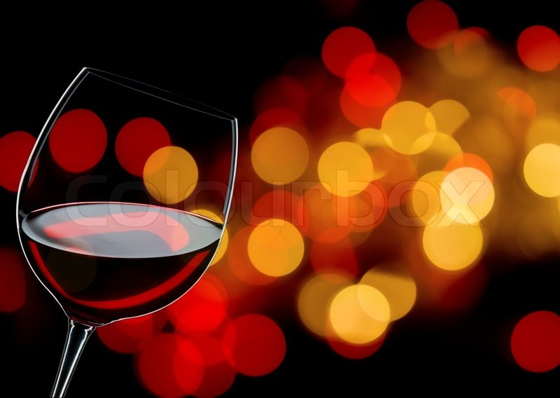 Glass Of Red Wine Close Up Background Lights Stock Photo