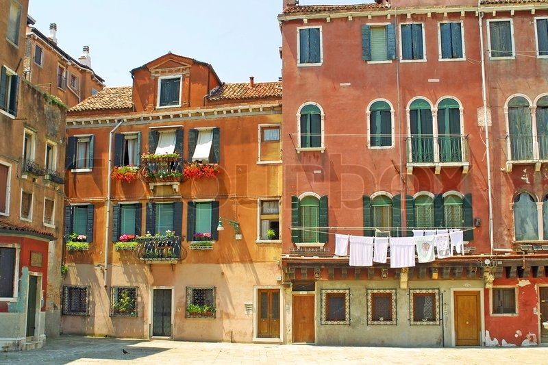 small plaza with colourful buildings in venice italy