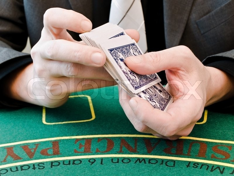 [Image: 1709710-580074-men-s-hands-shuffle-a-dec...-table.jpg]