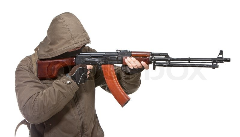 Terrorist with weapon on a white background, stock photo