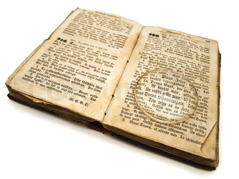 Old Bible With With Magnifying Glass Stock Photo