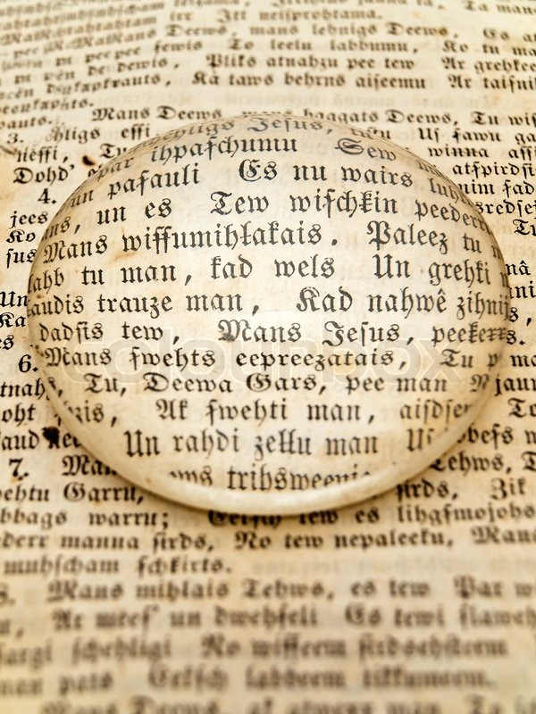 Old Page With Text Under Magnifying Glass Stock Photo