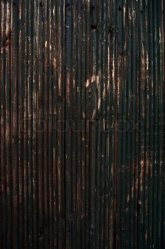 Worn Down Wooden Planks ~ Weathered and worn dark wooden a plank stock photo