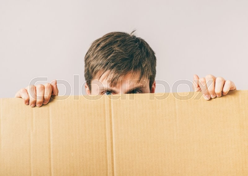 Young happy man holding a blank banner, stock photo