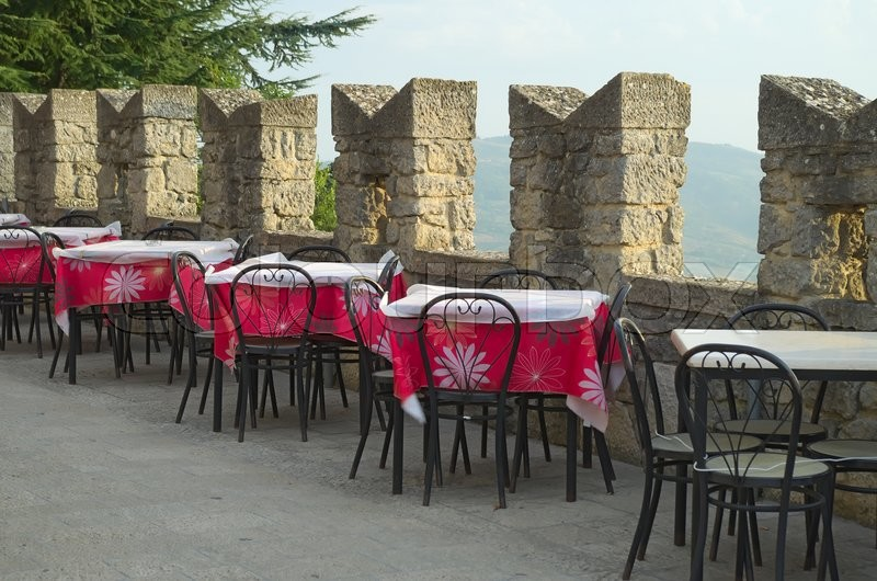 Coffee tables outdoor restaurant in the fortress of the Republic of San Marino, stock photo