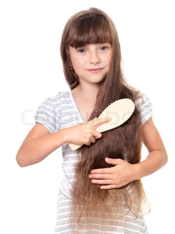 Pretty girl combing her hair stock photo colourbox urmus Choice Image