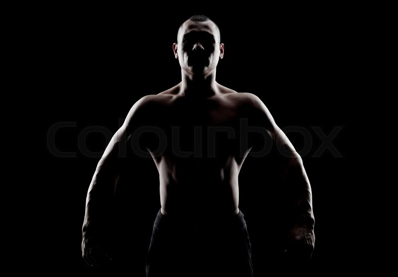 Silhouette Of A Strong Fighter Confident Young Fitness Man With Hands And Clenched Fists