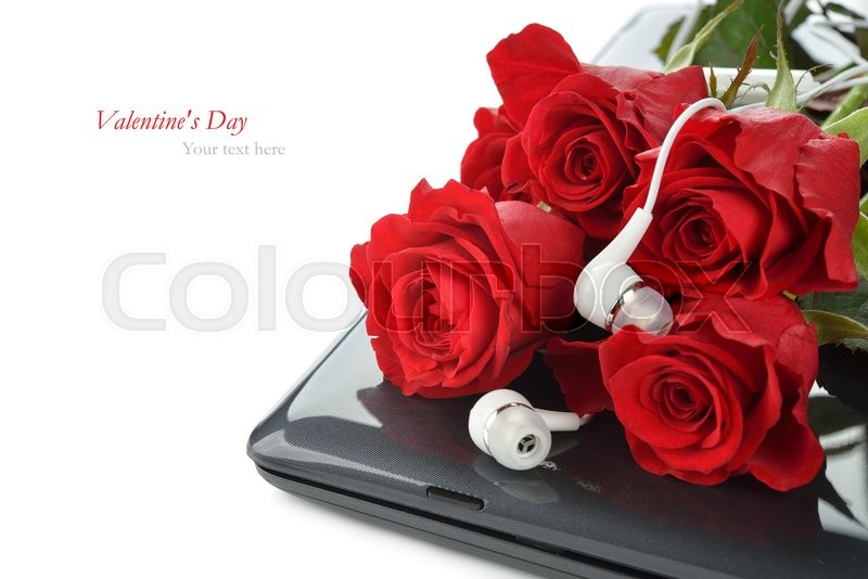 Computer and roses on a white background, Valentine\'s Day concept, stock photo