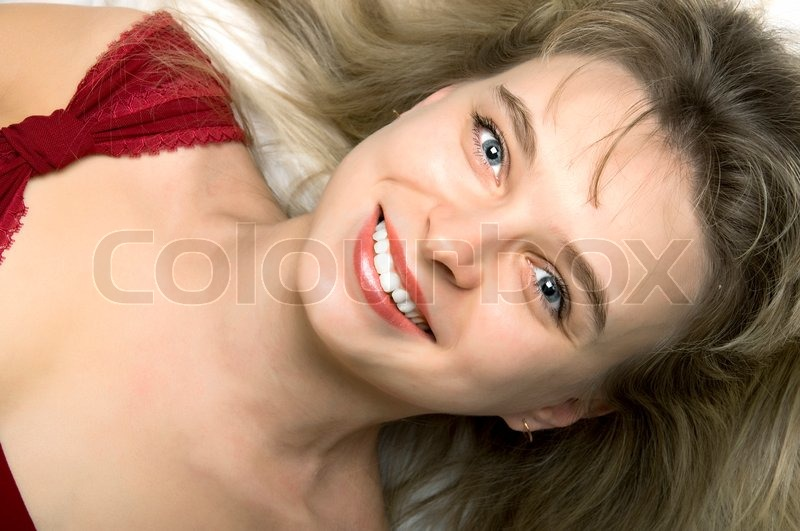 Young blond girl rose gown over white. High key, stock photo