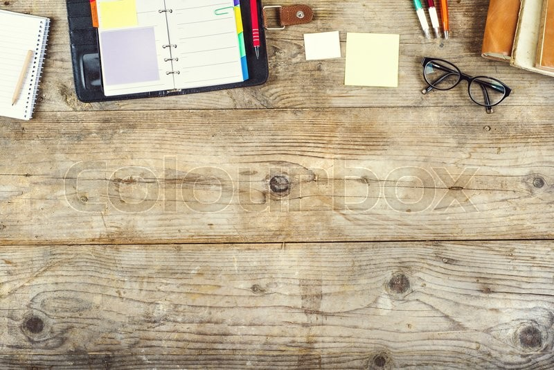 Mix of office supplies on a wooden table background  View from above     Stock Photo   Colourbox. Mix of office supplies on a wooden table background  View from
