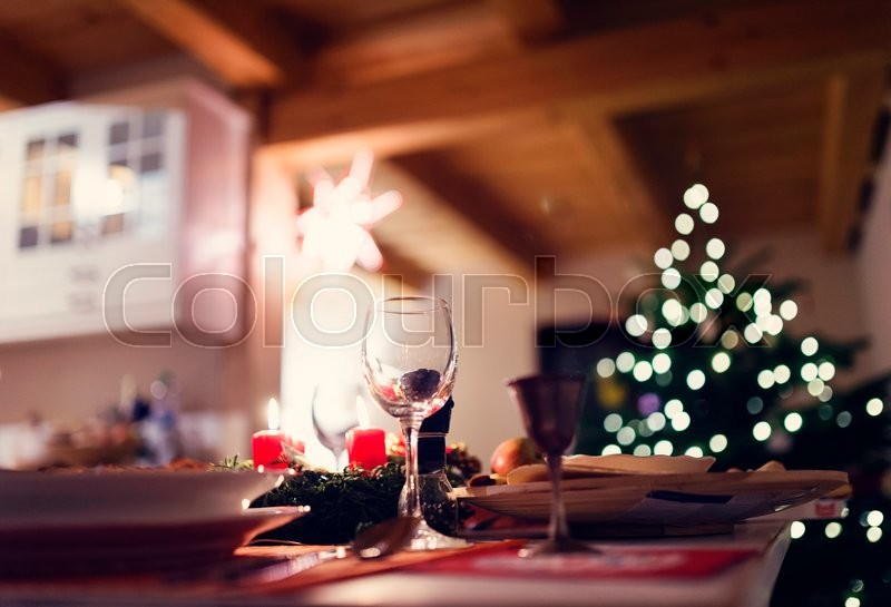 Christmas meal laid on a table in a decorated living room, stock photo