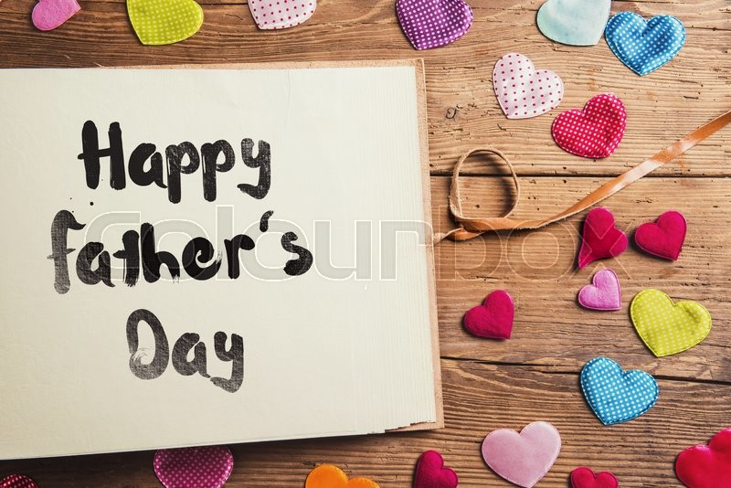 Fathers day composition with fabric hearts. Studio shot on wooden background, stock photo