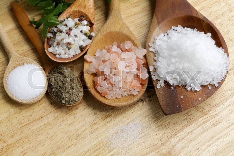 Different types of salt (pink, sea, black, and with spices), stock photo