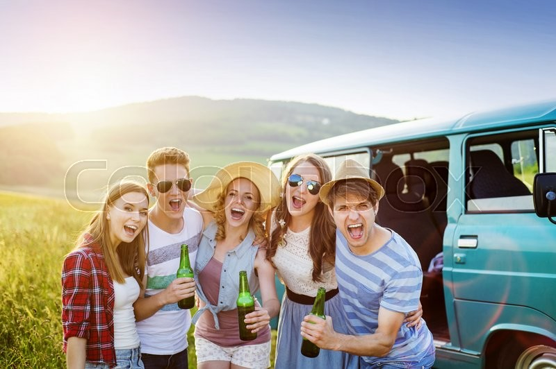 Young hipster friends on road trip on a ...   Stock Photo ...