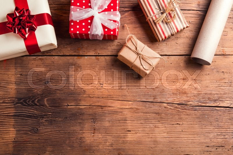 Christmas presents laid on a wooden table background, stock photo