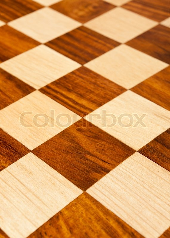 Wooden chess board with brown and yellow squares background . Natural wood, stock photo
