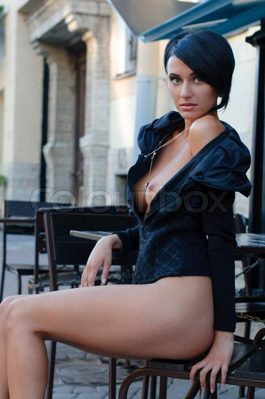 Stock image of 'Beautiful Woman with naked breast in the cafe outdoors'