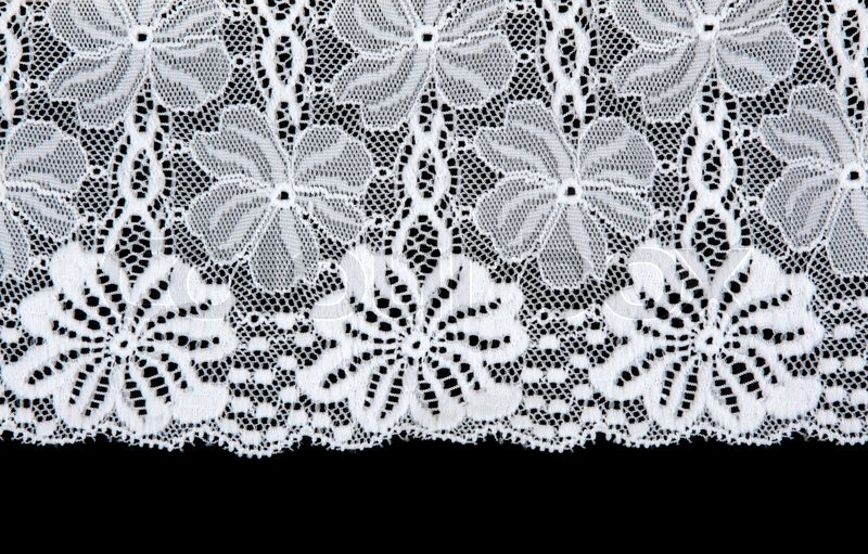 wei e spitzen mit muster in form blume auf schwarzem hintergrund isoliert stockfoto colourbox. Black Bedroom Furniture Sets. Home Design Ideas
