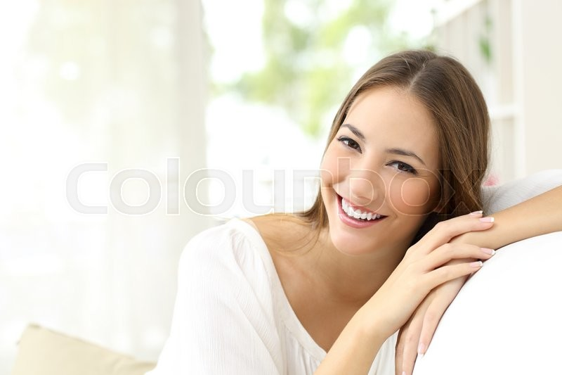 Beauty woman with white perfect smile looking at camera at home, stock photo