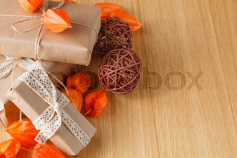 Paper wrapped gift box with fall theme, stock photo