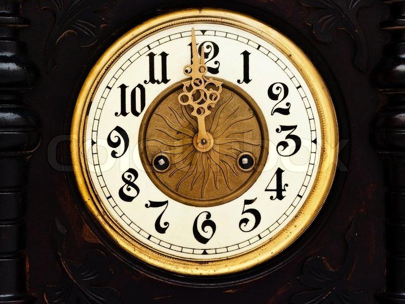 Old Wooden Clock With Golden Hands Show Twelve Stock