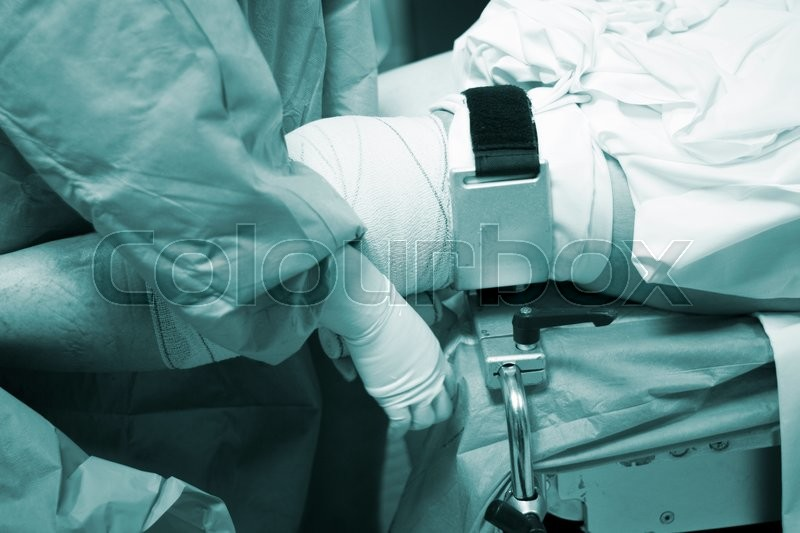 Knee arthroscopy orthopedic surgery operation in hospital emergency operating room photo, stock photo