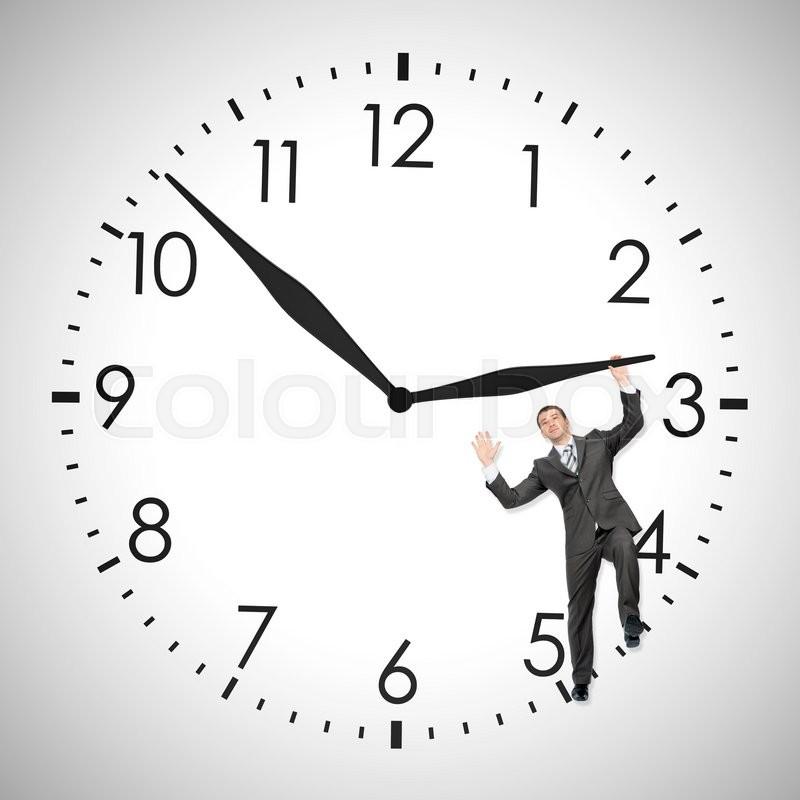 Businessman pushing clock hand inside clock isolated on white background, stock photo