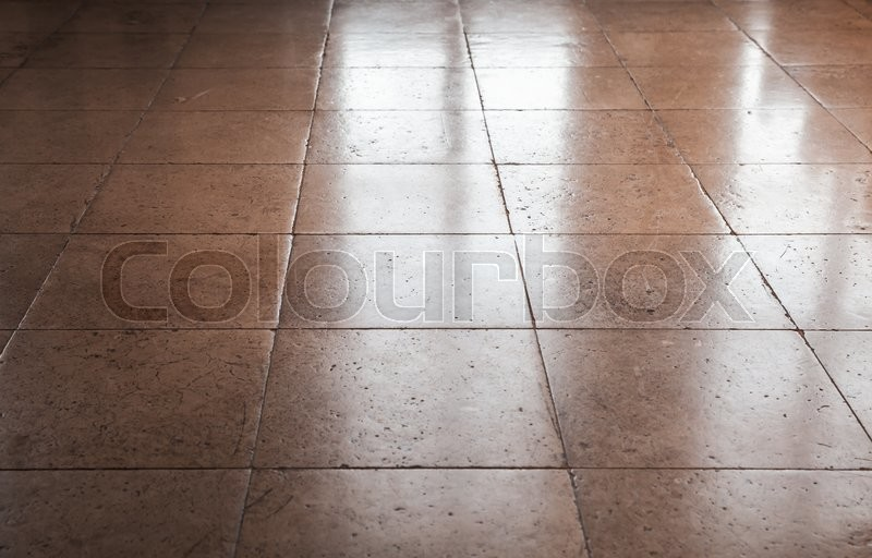 Shining brown stone floor tiling, background texture with perspective effect, stock photo